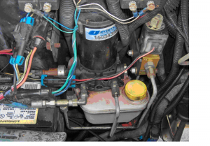 If you have the later version with the pump located up front under the utility hood to the driver's side of the radiator, it will look more like this