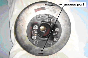 Typical Auto Park parking brake drum removed showing 2 access ports for adjusting the brake shoes